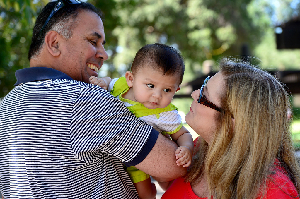 ". Suzy and Greg Campeau, of South Pasadena, who adopted their first child, 2-year-old Bella, last December, visit with Bella\'s 5-month-old brother Mason, who they had for 2 months, at their neighborhood park Saturday, May 11, 2013. This will be Suzy\'s first ""official\"" Mother\'s Day at age 51.  (SGVN/Staff Photo by Sarah Reingewirtz)"