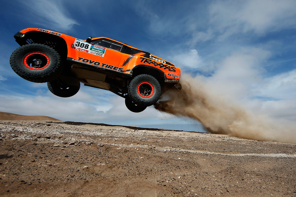 . IQUIQUE, CHILE - JANUARY 13:  #308 Robby Gordon and Johnny Campbell of the USA driving for Speed Energy Racing HST Hummer launches over a jump in the Atacama Desert during day 10 of the Dakar Rallly between Iquique on Calama January 13, 2015 in Iquique, Chile.  (Photo by Dean Mouhtaropoulos/Getty Images)