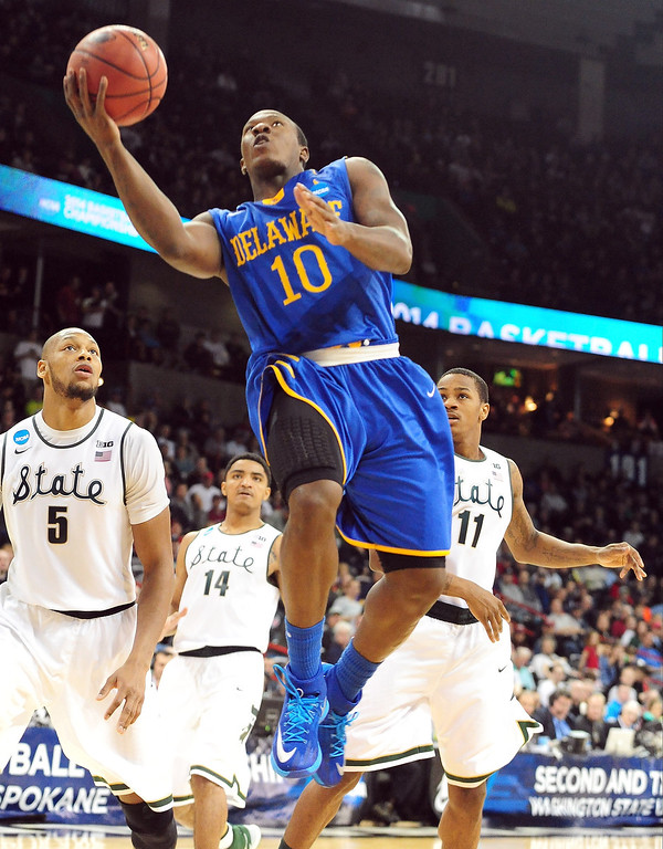 . Devon Saddler #10 of the Delaware Fightin Blue Hens goes up for a shot against the Michigan State Spartans in the second round of the 2014 NCAA Men\'s Basketball Tournament at Spokane Veterans Memorial Arena on March 20, 2014 in Spokane, Washington.  (Photo by Steve Dykes/Getty Images)
