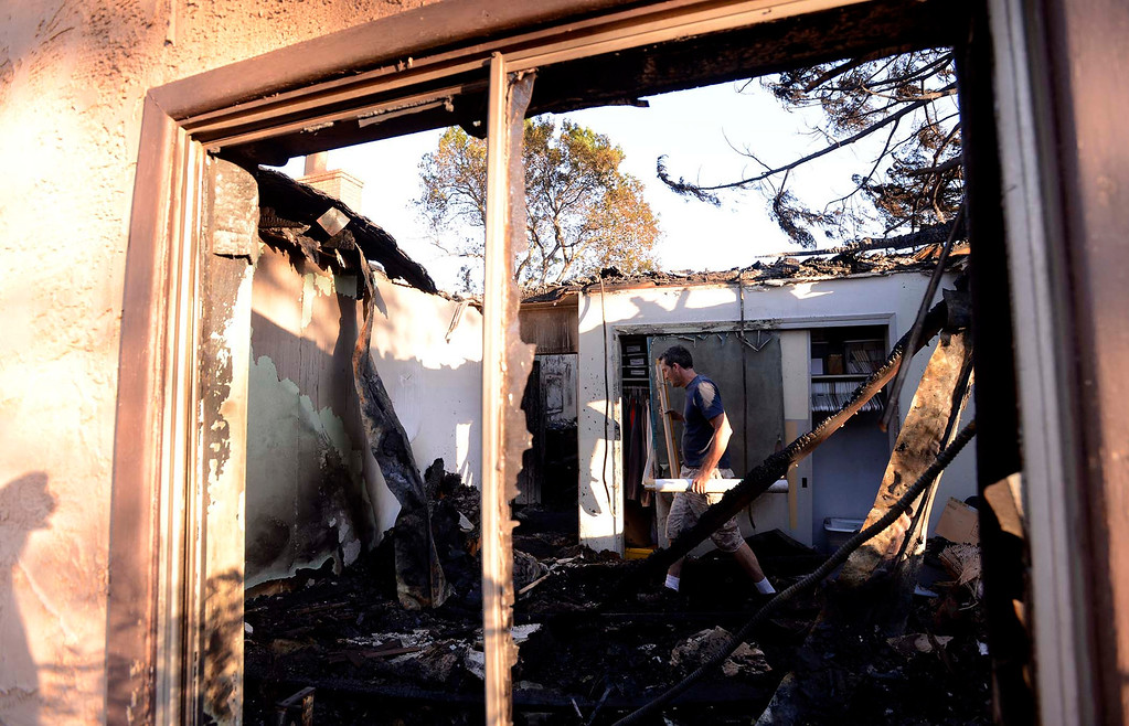 . Michael Kiener, 47, of San Diego, helps to retrieve items from his brother\'s burned out house along Mesa Road in Banning May 2, 2013.  The Kiener residence was the only structure to burn in the Summit Fire. GABRIEL LUIS ACOSTA/STAFF PHOTOGRAPHER.