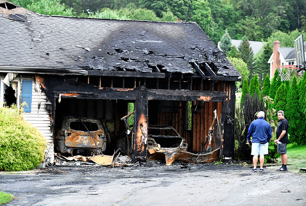 9/14/2019 Mike Orazzi | StaffrThe scene of a house fire on Deer Path Road in Newington on Saturday.