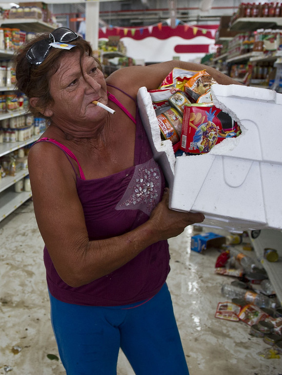 . A woman loots a supermarket in San Jose del Cabo, on September 15, 2014 after hurricane Odile knocked down trees and power lines in Mexico\'s Baja California peninsula. AFP PHOTO/RONALDO  SCHEMIDT/AFP/Getty Images