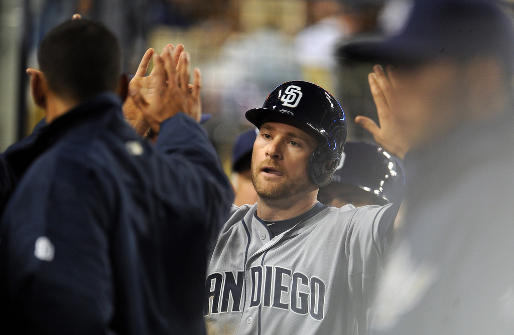 . San Diego Padres\' Chase Headley high fives teammates after scoring in the fourth inning of their baseball game against the Los Angeles Dodgers on Wednesday, April 17, 2013 in Los Angeles.   (Keith Birmingham/Pasadena Star-News)