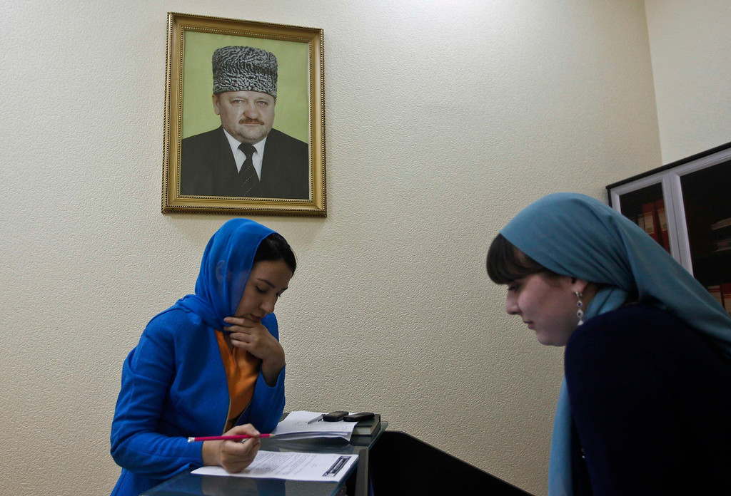 . An employee of a memorial complex devoted to former Chechen leader Akhmad Kadyrov signs documents in the Chechen capital Grozny April 26, 2013. The naming of two Chechens, Dzhokhar and Tamerlan Tsarnaev, as suspects in the Boston Marathon bombings has put Chechnya - the former site of a bloody separatist insurgency - back on the world\'s front pages. Chechnya appears almost miraculously reborn. The streets have been rebuilt. Walls riddled with bullet holes are long gone. New high rise buildings soar into the sky. Spotless playgrounds are packed with children. A giant marble mosque glimmers in the night. Yet, scratch the surface and the miracle is less impressive than it seems. Behind closed doors, people speak of a warped and oppressive place, run by a Kremlin-imposed leader through fear.   Picture taken April 26, 2013.  REUTERS/Maxim Shemetov