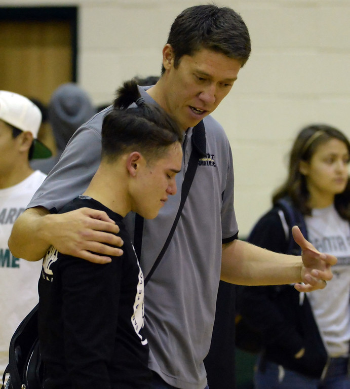 . Santa Fe head coach Chris Komer consoles a player as Damien defeated Santa Fe 25-17, 25-19, 29-27 during a prep semifinal volleyball match at Damien High School in La Verne, Calif., on Wednesday, May 20, 2015. (Photo by Keith Birmingham/ Pasadena Star-News)