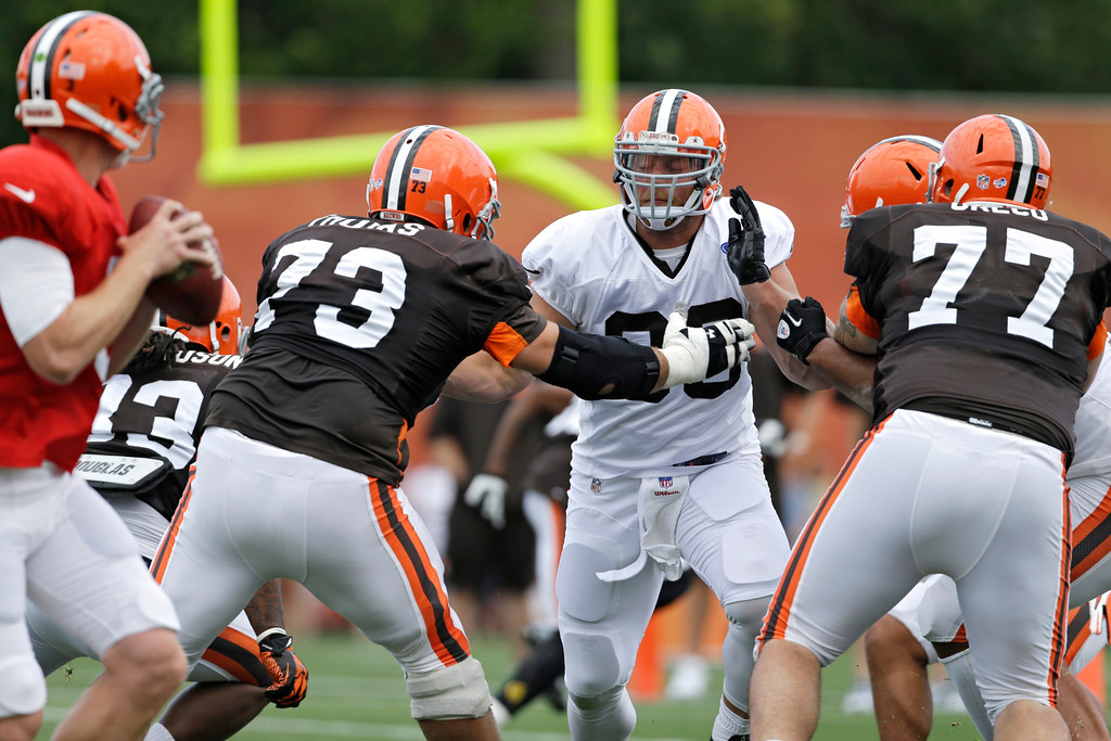 . Cleveland Browns linebacker Paul Kruger rushes against offensive tackle Joe Thomas (73) during training camp at the NFL football team\'s facility in Berea, Ohio Sunday, July 28, 2013. (AP Photo/Mark Duncan)