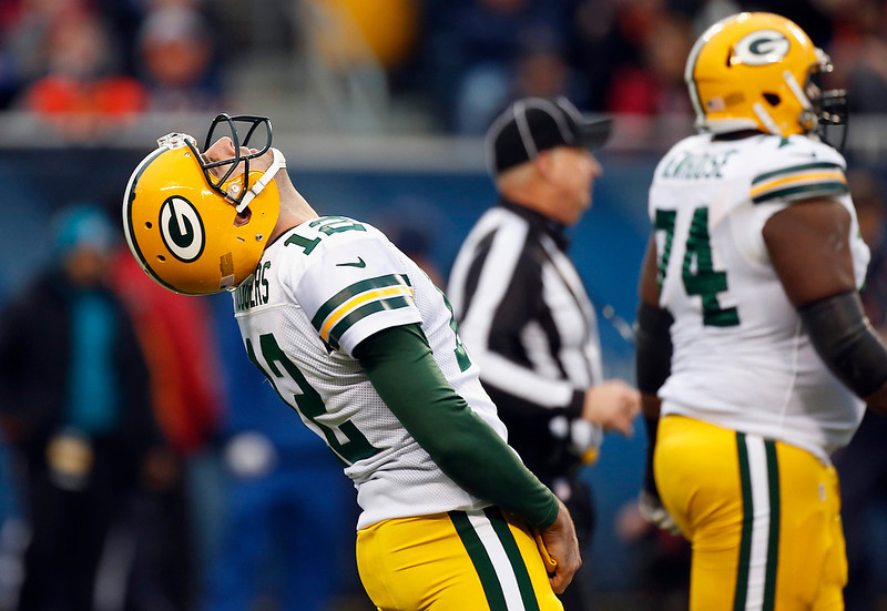 . Green Bay Packers quarterback Aaron Rodgers (12) reacts after a near interception by the Chicago Bears in the first half of an NFL football game in Chicago, Sunday, Dec. 16, 2012. (AP Photo/Charles Rex Arbogast)