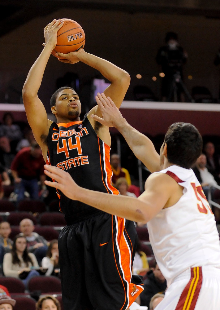 . Oregon State forward Devon Collier (44) shoots over Southern Cal center Omar Oraby (55) for a basket during the first half of an NCAA college basketball game, Saturday, Jan. 19, 2013, in Los Angeles. (AP Photo/Gus Ruelas)