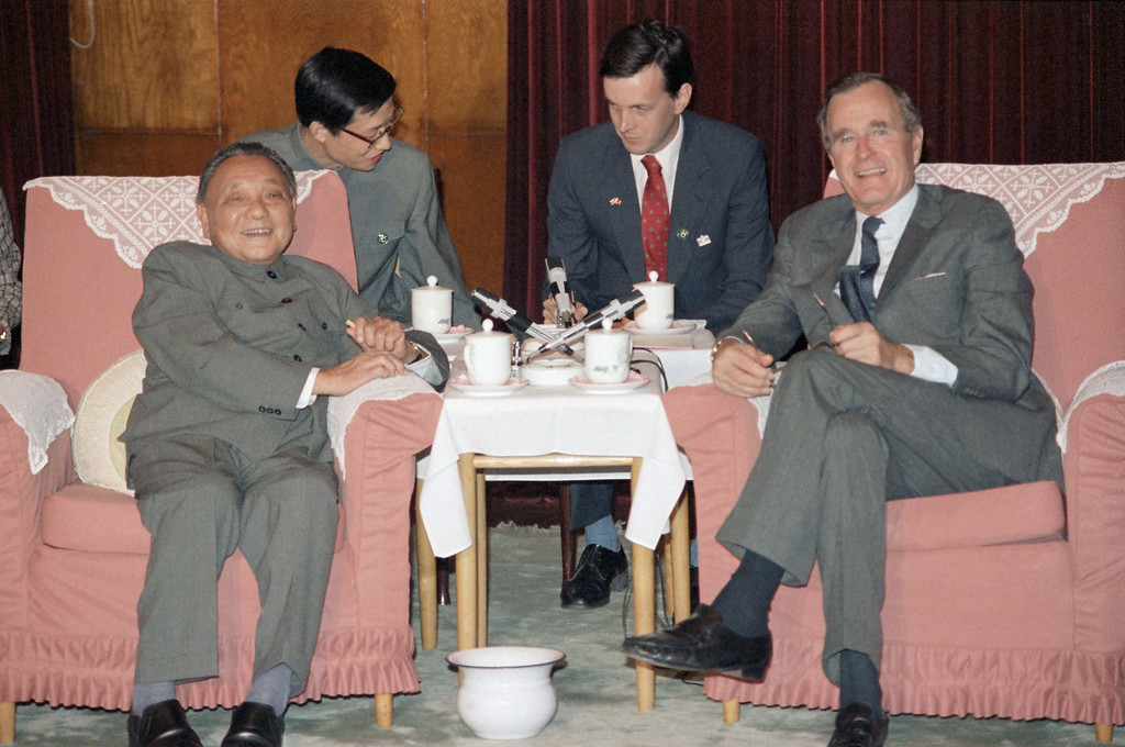 . 1985: Deng Xiaoping. U.S. Vice-President George H. W. Bush, right, and China\'s top leader, Deng Xiaoping meet in Beijing, China, Oct. 13, 1985. Interpreters in center are unidentified. (AP Photo/Neal Ulevich)