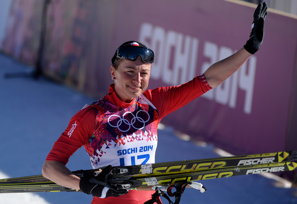 . Justyna Kowalczyk of Poland reacts after winning the Women\'s 10 km Classic during day six of the Sochi 2014 Winter Olympics at Laura Cross-country Ski & Biathlon Center on February 13, 2014 in Sochi, Russia.  (Photo by Harry How/Getty Images)