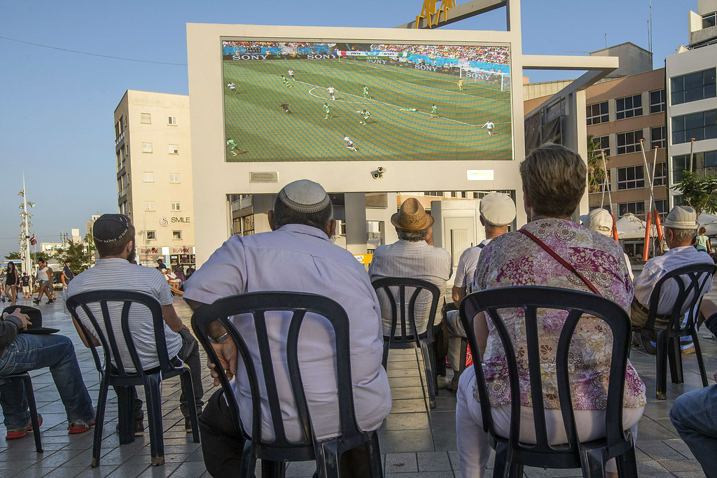 . French-Israelis watch on a giant screen the football match between France and Nigeria during the 2014 FIFA World Cup in Brazil, in the Israeli Mediterranean coastal city of Netanya, north of Tel Aviv, on June 30, 2014.   JACK GUEZ/AFP/Getty Images
