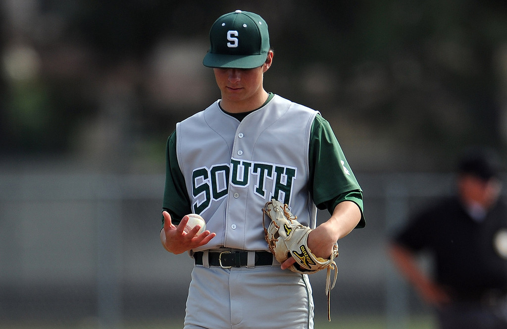. South (Torrance) starting pitcher Matt Mogollon looks down after Northview scores in the fourth inning of a CIF-SS prep second round playoff baseball game at Northview High School on Tuesday, May 21, 2013 in Covina, Calif. Northview won 5-4. 