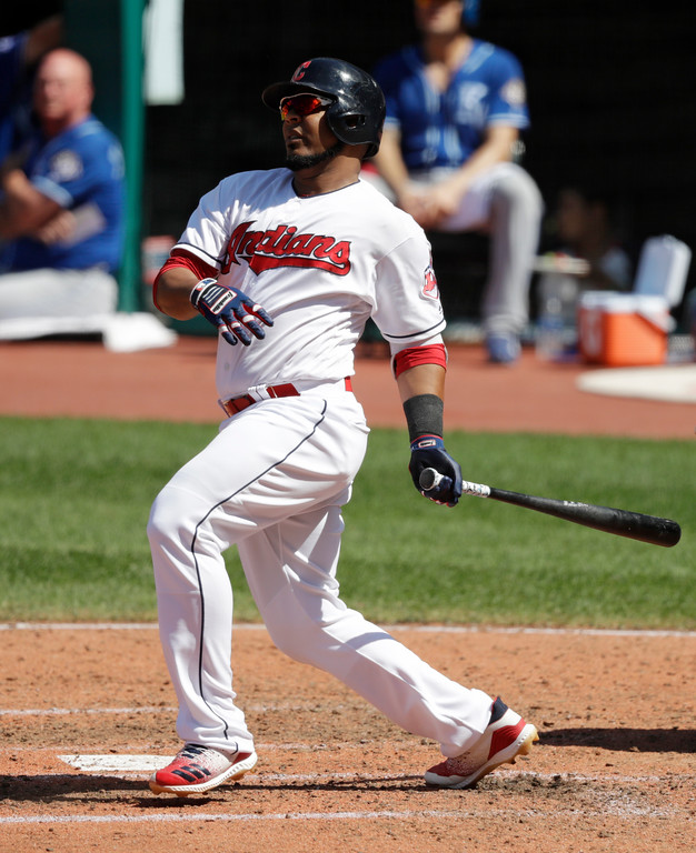 . Cleveland Indians\' Edwin Encarnacion grounds into a fielders choice in the fifth inning of a baseball game against the Kansas City Royals, Wednesday, Sept. 5, 2018, in Cleveland. Encarnacion was safe at first base and Michael Brantley scored on the play. (AP Photo/Tony Dejak)