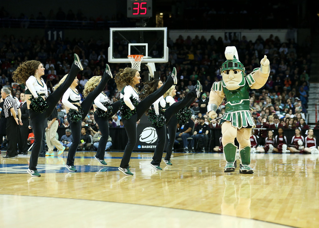 . Michigan State Spartans mascot, Sparty, and cheerleaders perform in their game against the Harvard Crimson during the Third Round of the 2014 NCAA Basketball Tournament at Spokane Veterans Memorial Arena on March 22, 2014 in Spokane, Washington.  (Photo by Stephen Dunn/Getty Images)