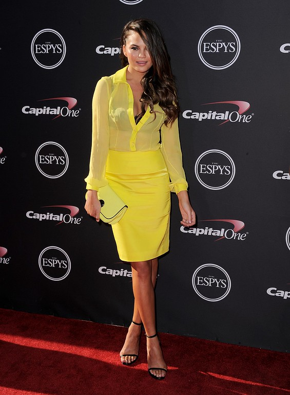 . Model Christine Teigen arrives at the ESPY Awards on Wednesday, July 17, 2013, at Nokia Theater in Los Angeles. (Photo by Jordan Strauss/Invision/AP)