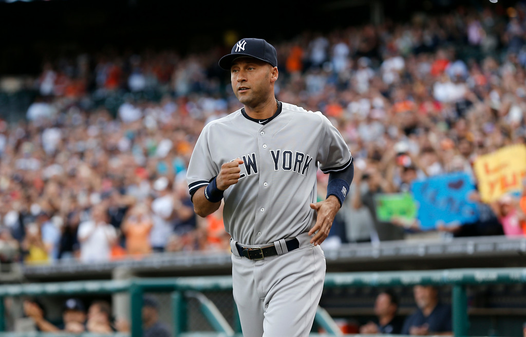 . New York Yankees shortstop and Michigan native Derek Jeter takes the field for a special pre-game on-field ceremony before a baseball game against the Detroit Tigers in Detroit Wednesday, Aug. 27, 2014. (AP Photo/Paul Sancya)