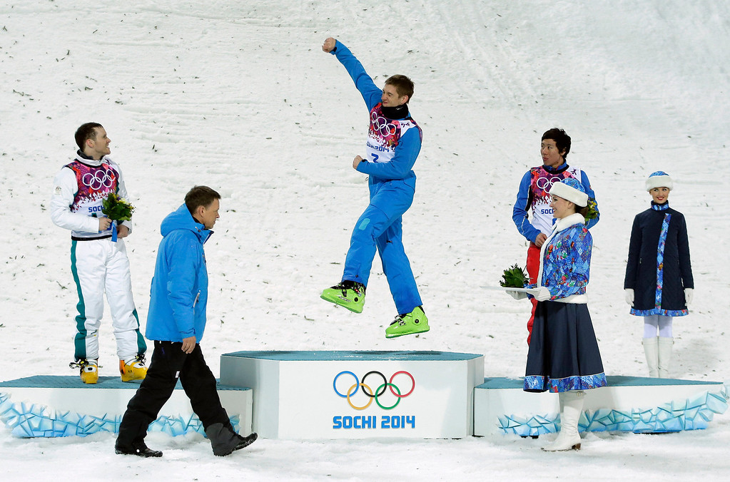 . Men\'s freestyle skiing aerials gold medal winner Anton Kushnir of Belarus, center, celebrates on the podium with Australia\'s David Morris (silver), left, and China\'s China\'s Jia Zongyang (bronze), right, during a flower ceremony at the Rosa Khutor Extreme Park, at the 2014 Winter Olympics, Monday, Feb. 17, 2014, in Krasnaya Polyana, Russia. (AP Photo/Charlie Riedel)