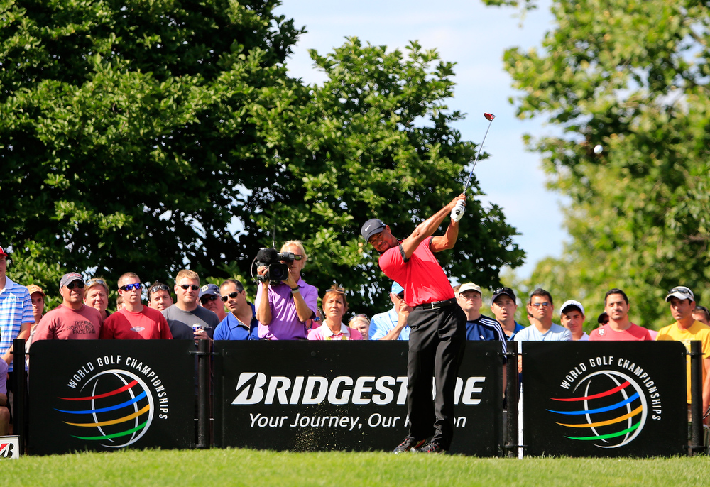. Tiger Woods hits off the 15th tee during the Final Round of the World Golf Championships-Bridgestone Invitational at Firestone Country Club South Course on August 4, 2013 in Akron, Ohio.  (Photo by Sam Greenwood/Getty Images)
