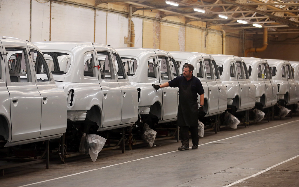 . Joel McDougal inspects unpainted body shells of TX4 (Euro 5) London Taxis inside the factory of The London Taxi Company on September 11, 2013 in Coventry, England.  (Photo by Matt Cardy/Getty Images)
