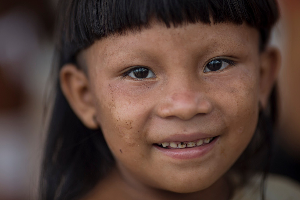 . An Enawene Nawe Indian looks at the camera during the indigenous games in Cuiaba, Brazil, Tuesday, Nov. 12, 2013. (AP Photo/Felipe Dana)