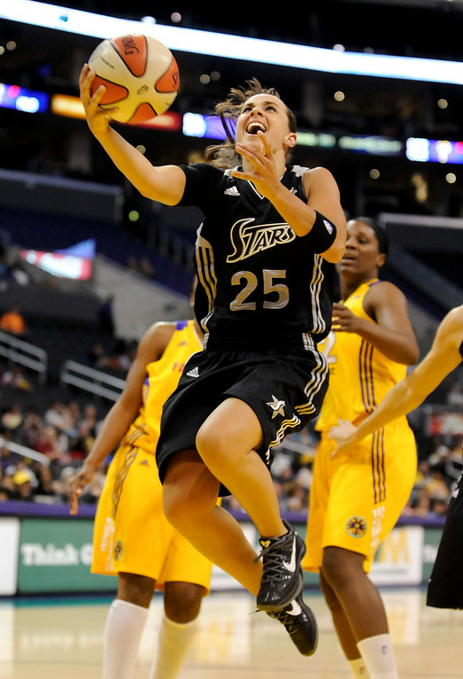 . San Antonio Silver Stars guard Becky Hammon drives to the basket on a fast break in the first half of a WNBA basketball game against the Los Angeles Sparks, Tuesday, Sept. 6, 2011, in Los Angeles. The Silver Stars won 82-65. (AP Photo/Gus Ruelas)