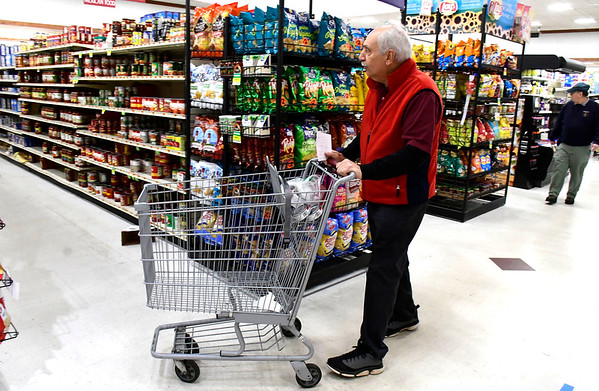 4/2/2020 Mike Orazzi | Staff Gary Hovhanessian while grocery shopping at Gnazzo's Food Center in Plainville on Thursday.