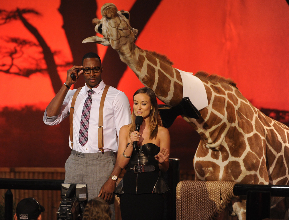 . CULVER CITY, CA - JUNE 08:  NBA player Dwight Howard and actress Olivia Wilde speak onstage during Spike TV\'s Guys Choice 2013 at Sony Pictures Studios on June 8, 2013 in Culver City, California.  (Photo by Kevin Winter/Getty Images for Spike TV)