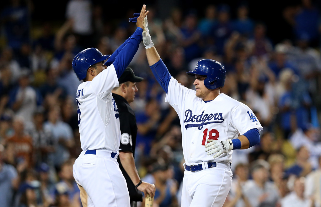 . LOS ANGELES, CA - JULY 11:  Tim Federowicz #18 and Jerry Hairston Jr. #6 of the Los Angeles Dodgers celebrate after both score on mark Ellis\' two run double in the eighth inning against the Colorado Rockies at Dodger Stadium on July 11, 2013 in Los Angeles, California.  (Photo by Stephen Dunn/Getty Images)