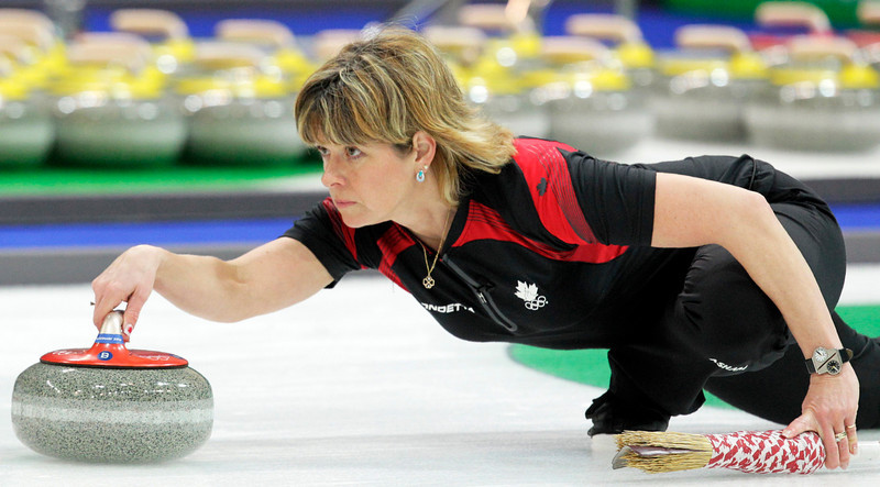 . Canada\'s Carolyn Darbyshire takes a shot during the gold medal women\'s curling match against Sweden at the Vancouver 2010 Olympics in Vancouver, British Columbia, Friday, Feb. 26, 2010. (AP Photo/Jae C. Hong)
