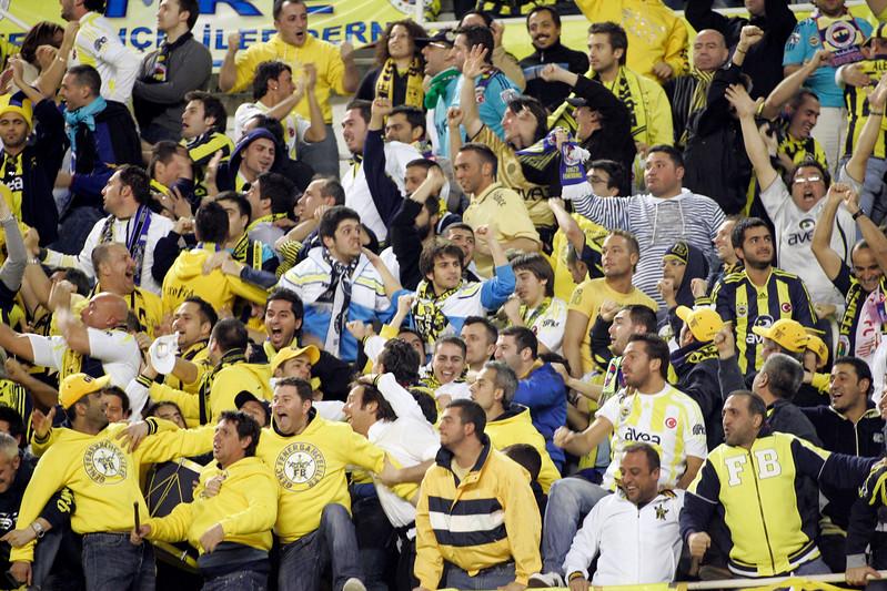 Fenerbahçe fans celebrating a goal. UEFA Champions League first knockout round game (second leg) between Sevilla FC (Seville, Spain) and Fenerbahce (Istambul, Turkey), Sanchez Pizjuan stadium, Seville, Spain, 04 March 2008.