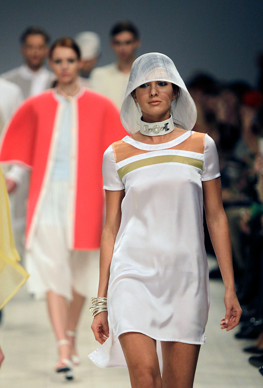 . A model displays outfits by Ukrainian designer Olga Timkova-Lyakhovska during fashion week in Kiev, Ukraine, Sunday, Oct. 13, 2013. (AP Photo/Sergei Chuzavkov)