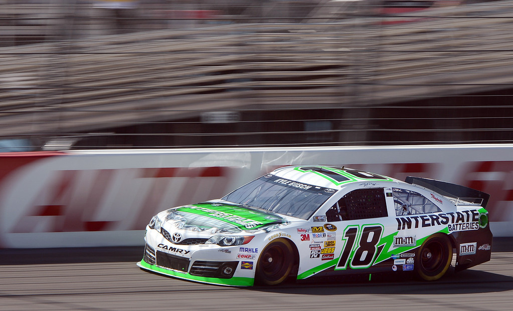 . (Will Lester/Staff Photographer) NASCAR driver Kyle Busch races down the front straightaway during the opening practice session for Sunday\'s Auto Club 400 Friday March 22, 2013.