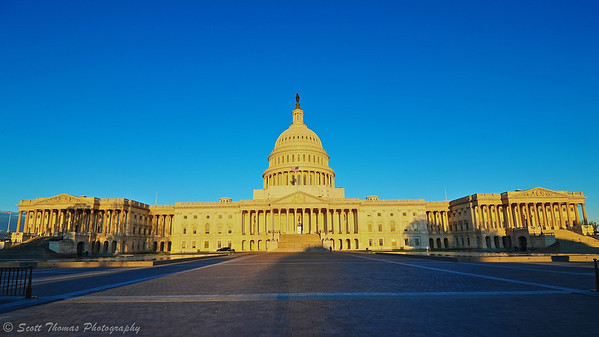 The United State Capitol Building in golden sunlight at 7AM in Washington, D.C.