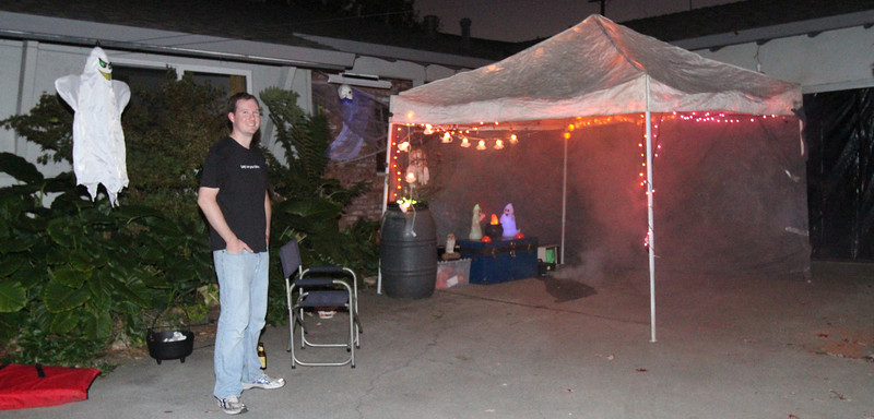 The reception area provided a source of candy for those not willing to enter the scene.  The hanging ghost lit up, moved across the driveway, and moaned in response to a sensor detecting someone nearby.