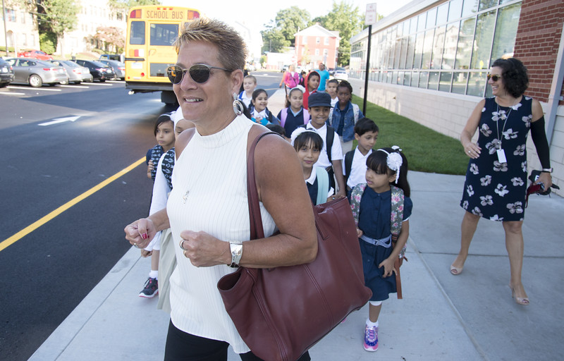 09/03/19  Wesley Bunnell | Staff  Superintendent of Schools Nancy Sarra leads the first bus full of students to their waiting areas as they arrive at Smalley School on for their first day on Tuesday September 3, 2019.