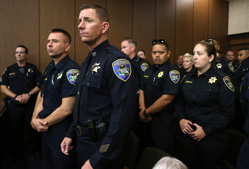 . Members of the Hayward Police Department attend an arraignment hearing for Mark Estrada, 21, at the Hayward Hall of Justice in Hayward, Calif., Friday, July 24, 2015. Estrada is accused of fatally shooting Hayward Police Sgt. Scott Lunger. (Anda Chu/Bay Area News Group)