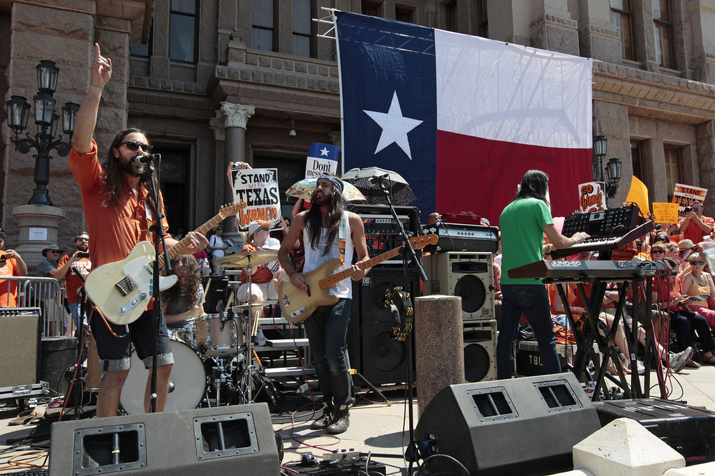 ". Austin rock group The Bright Light Social Hour sing their song ""Wendy Davis\"" during a rally in support of Texas women\'s right to reproductive decisions at the Texas State capitol on July 1, 2013 in Austin, Texas. This is first day of a second legislative special session called by Texas Gov. Rick Perry to pass a restrictive abortion law through the Texas legislature. The first attempt was defeated after opponents of the law were able to stall the vote until after the first special session had ended.  (Photo by Erich Schlegel/Getty Images)"