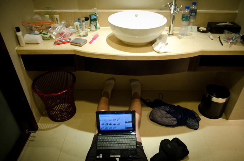 Keith managing almost 2000 photos and videos from the bathroom floor at 5:00 AM