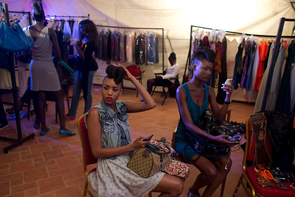 . Models wait backstage at Hotel des Almadies, in Dakar, Senegal, Saturday, June 22, 2013. After a Friday show held in a dusty marketplace in the working class suburb of Guediawaye, the runway finale of Dakar Fashion Week was held at a luxury hotel and showcased the work of 14 designers from West Africa, Europe, South America, and the Caribbean. (AP Photo/Rebecca Blackwell)