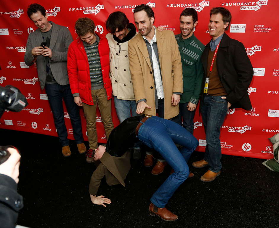 ". Cast member Gaby Hoffmann leans over backwards in front of other including actor Michael Cera, second left, and director Sebastian Silva, third right, as they pose together at the premiere of ""Crystal Fairy\"" during the 2013 Sundance Film Festival on Thursday, Jan. 17, 2013 in Park City, Utah. (Photo by Danny Moloshok/Invision/AP)"