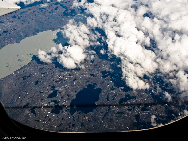 Near the west coast of Greenland. The dark line in the lower part of the picture is the shadow of the 767's contrail.