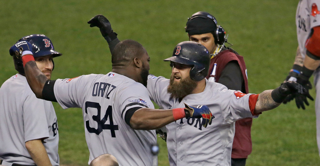. Boston Red Sox\'s David Ortiz celebrates with Mike Napoli after Napoli hits a home run in the seventh inning during Game 3 of the American League baseball championship series against the Detroit Tigers Tuesday, Oct. 15, 2013, in Detroit. (AP Photo/Carlos Osorio)