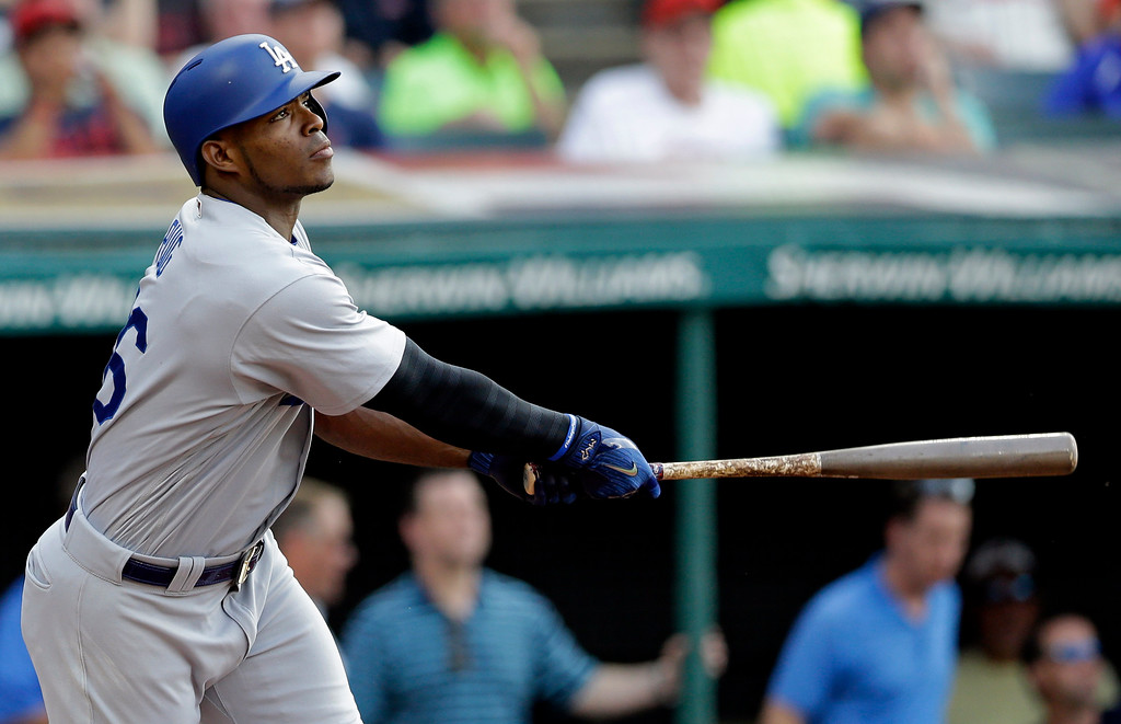 . Los Angeles Dodgers\' Yasiel Puig watches his two-run home run off Cleveland Indians starting pitcher Trevor Bauer during the second inning of a baseball game, Tuesday, June 13, 2017, in Cleveland. (AP Photo/Tony Dejak)