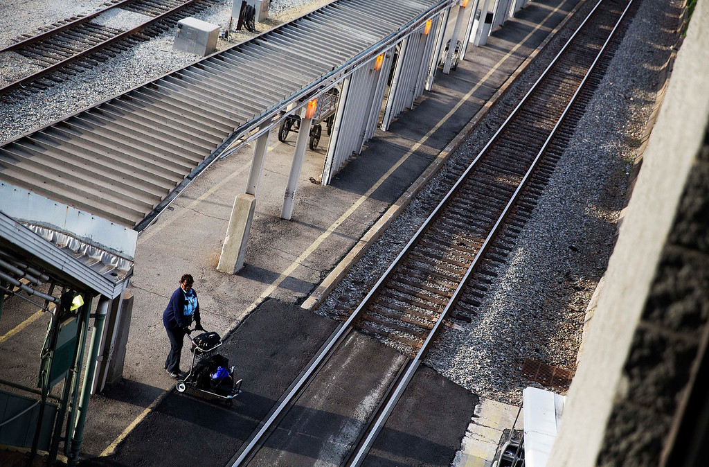 . Conductor Mary Allen crosses the tracks with her luggage as she waits for a train to New Orleans to arrive to begin her shift in Atlanta, Wednesday, Nov. 23, 2016. Almost 49 million people are expected to travel 50 miles or more for the Thanksgiving holiday, the most since 2007, according to AAA. (AP Photo/David Goldman)