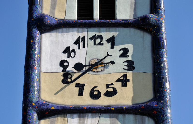 Detail of Clock at St. Barbara-Kirche (Church of Saint Barbara, patron of miners) renovated by Friedensreich Hundertwasser in Bärnbach, Styria, Austria