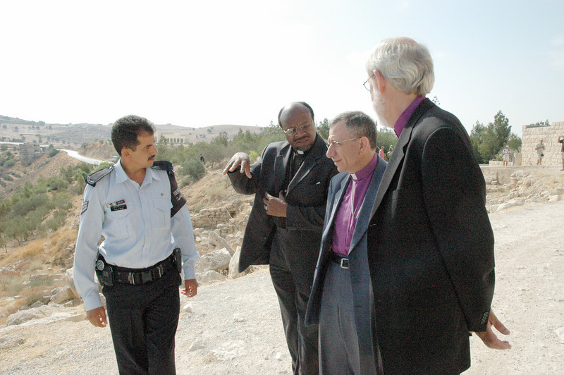 Bishop Mark Hanson, right, ELCA presiding bishop and Lutheran World Federation (LWF) president joined Bishop Munib Younan, Evangelical Lutheran Church in Jordan and the Holy Land and LWF vice president, second from right, and LWF General Secretary Dr. Ishmael Noko, in a tour of Mr. Nebo in Jordan.  In the Bible Mt. Nebo is named as the place of Moses death.  A memorial to Moses has been excavated.  With the three LWF leaders is a tour guide, left.
