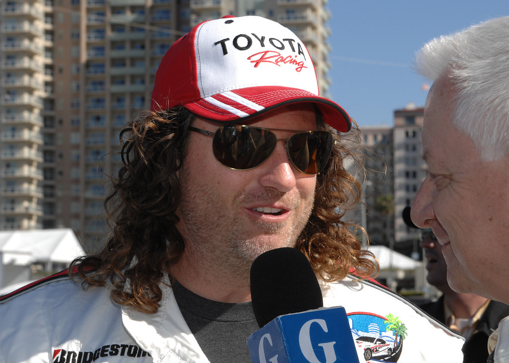 . 4/9/13 - Andy Bell gives an interview on media day for the 39th Annual Toyota Grand Prix of Long Beach. The celebrity/pro races spent the day practicing on the track, joking with their racing partners and giving interviews. Photo by Brittany Murray / Staff Photographer
