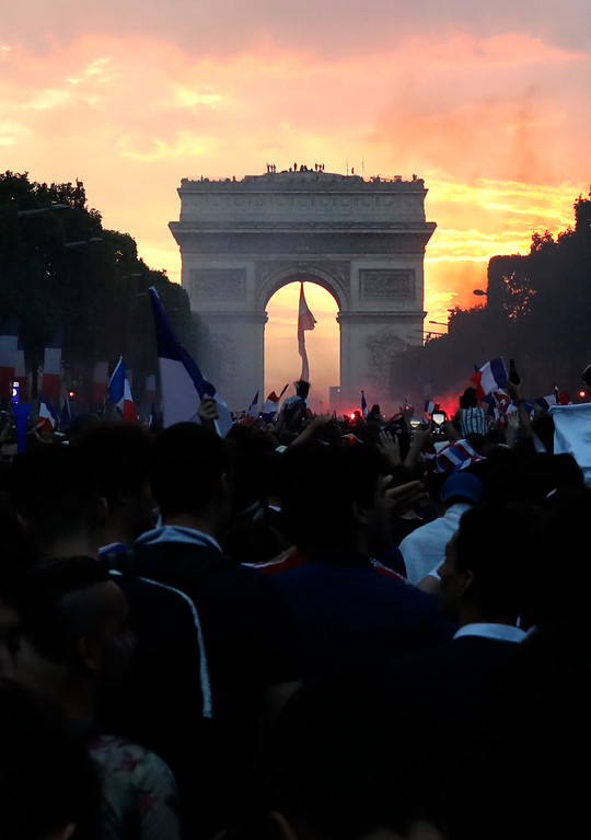 . People invade the Champs Elysees avenue after France won the World Cup final between France and Croatia, Sunday, July 15, 2018 in Paris. France won its second World Cup title by beating Croatia 4-2. (AP Photo/Laurent Cipriani)