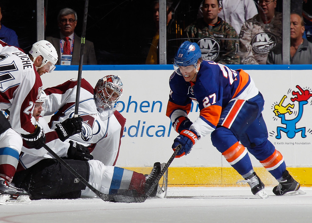 . UNIONDALE, NY - NOVEMBER 11: The Colorado Avalanche line up to stop Anders Lee #27 of the New York Islanders during the third period at the Nassau Veterans Memorial Coliseum on November 11, 2014 in Uniondale, New York.  The Islanders shutout the Avalanche 6-0. (Photo by Bruce Bennett/Getty Images)