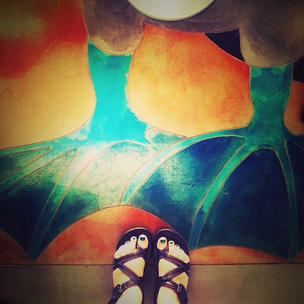 Going_through_entry_point_in_Galapagos_I_see_my_pedicure_colour_is_the_same_as_the_Blue_Footed_Bobbie_mural_feet._I_did_not_plan_this_in_advance..jpg